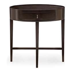 Bernhardt - Bernhardt Haven Oval Shaped  Nightstand in Raven - A circular shaped top with slim, tall tapered legs give this nightstand a modern look. The drawer is small and perfect for personal items you want close to your bedside while the top can hold a lamp, clock or an item you want on display.