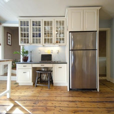 Wide plank floors & white cabinets