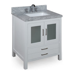 Kitchen Bath Collection - Manhattan 30-in Bath Vanity (Carrara/White) - This bathroom vanity set by Kitchen Bath Collection includes a white cabinet with tempered glass windows, soft close drawers and self-closing door hinges, double-thick Italian Carrara marble countertop (an incredible 1.5 inches at the edge!), single undermount ceramic sink, pop-up drain, and P-trap. Order now and we will include the pictured three-hole faucet and a matching backsplash as a free gift! All vanities come fully assembled by the manufacturer, with countertop & sink pre-installed.