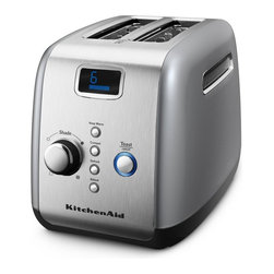 KitchenAid - KitchenAid KMT223 2 Slice Digital Motorized Toaster - Contour Silver - KMT223CU - Shop for Toasters from Hayneedle.com! The KitchenAid KMT223 2 Slice Digital Motorized Toaster - Contour Silver has the stylish look you'd expect to see when visiting the Jetsons. Its all-metal construction and sleek appearance are just the beginning - this baby has skills. A one-touch lift control keeps your toast from flying out an adjustable shading control regulates toast color and you can toast to your preference with the several options provided: keep warm bagel defrost reheat and toast/cancel. Slick. About KitchenAidFor over 80 years KitchenAid has been devoted to creating innovative cookware that inspires culinary excellence. From the original Stand Mixer first created in Troy Ohio this industry leader now offers a wide assortment of cookware bakeware kitchen accessories and appliances. All products are designed with your cooking needs in mind and are engineered to exceed the highest manufacturing standards. Since 1919 KitchenAid has been synonymous with quality and value. As a result all KitchenAid products are backed by exceptional industry-leading warranties. Check out the complete line today.