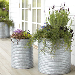 Galvanized Steel Planter with Handles - Oversize planters are the perfect accessories to create a statement in an outdoor room. With these galvanized planters, you can bring a bit of the past to your porch.