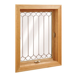 """Awning Windows - Wellington Awing Window; shown in Lite Oak wood grain and 3/8"""" Lead Scalloped Grids."""