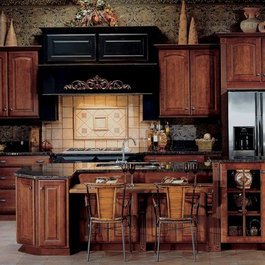 This beautiful kitchen has solid cherry doors with a raised panel ...