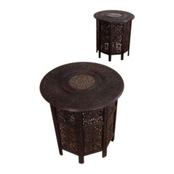 Used Elaborately Carved Asian Teak Side Tables - A Pair - Pair of two vintage elaborately carved Asian side tables. Bases are comprised of multifaceted panels. Each panel features an intricately carved motif of leaves and vines. Circular table top surface is a marvel of etchings and marquetry. The richly textured edifices are a delight to the eyes. Solid teak has been stained (original) to a deep coffee bean brown.