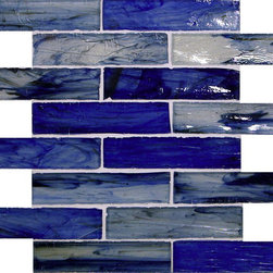 "Glass Tile Oasis - Pacific Blue 1 3/8"" x 6"" Blue Pool Glossy Glass - Sheet Size: .96 Sq. Ft.     Tile Size:  1 3/8"" x 6""     Tiles per sheet:  16     Tile thickness:  1/4""      Grout Joints:  1/8""     Recycled:  70% recycled glass     Sheet Mount:  Paper Face      Sold by the sheet      -  Waterfall glass tiles are each a one of a kind work of art. Each style features complimentary colors  shot through with transparent layers of contrasting colors. Mosaics are stacked together creating a unique repeating pattern.Waterfall are hand-poured and will have a certain amount of variation and variegation of color  tone  shade and size. Additionally  you will notice creases  wrinkles  shivers  waves  bubbles topped off with a natural surface to catch all forms of light for a brilliant effect. These characteristics of natural glass only serve to enhance the final beauty of the installation."
