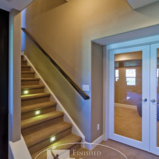 Modern Staircase by Finished Basement Company