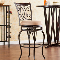 """Wildon Home � - Rodney Swivel Stool - Complement your décor with elegant, convenient seating. The intersected scrollwork and curved legs of this stool create a refined, stylish look. A powder-coated, dark champagne finish and durable steel frame deliver lasting quality. It features height seating, a cozy foam seat covered in plush mocha microfiber, and a scrolled backrest with a rich walnut finish wood accent. A full 360 degree swivel and footrest ring provide comfort and ease. The curvaceous form and attractive finish coordinate with traditional to contemporary décor styles. Ideal for the kitchen, breakfast nook, bar, or dining area. The handcrafted touch of artisan skill also creates variations in color and design; slight differences should be expected. Features: -Champagne brown finish frame with rich walnut finish backrest and mocha seat cushion- 3"""" THICK. -Constructed of powder-coated steel, poplar, polyester microfiber, particle board, and polyurethane foam. -Sturdy steel frame with plush microfiber seat and fire-retardant foam cushion. -Smooth 360 degree swivel. -Convenient footrest ring for ultimate comfort. -Curved backrest for optimum support. Dimensions: -Backrest: 17.75"""" H x 17.25"""" W. -Cushions thickness: 3"""". -25.25-in. Seat: 25.25"""" H x 16.75"""" Dia.. -25.25-in. Footrest height: 6.5"""". -29.75-in. Seat: 29.75"""" H x 16.75"""" Dia.. -29.75-in. Footrest height: 10.5"""". -25.25-in. Overall: 39.5"""" H x 21"""" W x 22.5"""" D, 30 lbs. -29.75-in. Overall: 44"""" H x 21.5"""" W x 23.25"""" D, 30 lbs . -Max weight capacity: 250 lbs."""