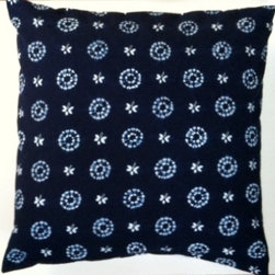 """Indigo blue batik, shibori, tie-dye and block print - Hand woven and indigo tie-dyed Japanese nui shibori fabric on face. Solid white organic cotton fabric on back. Hidden bottom zipper. 22"""" x 22"""". Cover made in U.S.A. This indigo-dyed shibori cotton fabric is hand-stitched and dyed in Japan."""