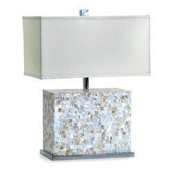Shell Tile Lamp - Shimmering with shades of taupe and even soft blues within their pearl white depths, the squares of iridescence that make up the Shell Tile Lamp's base have an organic complexity which contrasts with their regular geometry and with the more precise polish of the lip of chrome on which the rectangular block lamp base rests.  A neat white shade finishes the look.