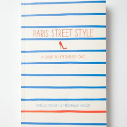 Paris Street Style - Stripes, the staple in any French woman's wardrobe, steal the show on the cover of this perfectly pretty book. With sketches and photos of Parisian street style, it is the ticket to a chic tomorrow.