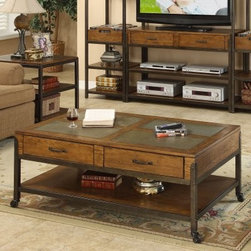 Riverside West End Rectangle Drawer Coffee Table - Slate inserts in the top of the Riverside West End Rectangle Drawer Cocktail Table provide a gorgeous accent against the Heirloom Russet wood finish. Made from engineered wood with ash veneers this beautiful cocktail table has a metal frame with metal legs and caster wheels for easy mobility. A fixed bottom shelf provides storage or display space while two storage drawers give you a convenient place to keep magazines or remote controls. The drawers have a dovetail construction to ensure strength and durability and wood-on-wood guides for smooth opening and closing. This cocktail table's mix of rustic and contemporary elements is sure to bring you compliments from all of your guests! About Riverside FurnitureRiverside has been growing for more than half a century. The company's founder Herman Udouj opened the doors to his first factory in 1946 and along with 12 employees he began making handcrafted furniture for the post-World War II Baby Boom era. Since then generations of customers have furnished their homes and offices with Riverside's wide range of furniture products. Riverside strives to be trusted for quality products that are an affordable value. It's just that simple. Notes on Riverside ConstructionAll Riverside domestic furniture is constructed of fine oak ash poplar and pine wood. These wood types are durable and feature beautiful open grains that make them much preferred among furniture manufacturers. Each piece of wood is first graded for quality then kiln-dried to remove excess moisture and prevent splitting. The wood is then constructed into a high-quality furniture piece using a combination of hardwood solids and hand-selected veneers. Techniques used on Riverside pieces include dovetail joinery heavy-duty drawer roller guides and multi-step finish applications that include hand-sanding and polishing for a deep lustrous result. All Riverside furniture is given this high-quality treatment to ensure the beauty and durability of your final product.