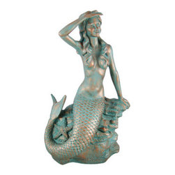 23 Inch Tall Mermaid On Rock Statue Verdigris Finish - This beautiful copper finished statue of a mermaid on a pile of rocks is a perfect decor item for anyone that loves mermaids. Made of cold cast resin, the statue has a metallic copper finish, and is then washed with a greenish-gray enamel to give it an oxidized, verdigris-like look. The statue measures 23 inches tall, 13 inches wide and 10 inches deep. It has wonderful detail, and shows great personality. It makes a great gift for family and friends.