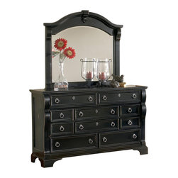 American Woodcrafters - Heirloom Triple Dresser w Mirror - Traditional style. Dresser with ten drawers. Felt bottoms on top drawers. Small drawers with center guided metal drawer glides. Larger drawers with double guided metal drawer glides. Drawers are 14.5 in. front to back for optimal storage. Framed end panels. Drawers with wood molding with mitered corners. Plastic drawer stops. Dust proofing on bottom drawers for added protection. English dovetail drawer construction with solid wood sides and backs. Tip resistant furniture bracket. Pewter rings and escutcheons. Landscape mirror with beveled glass. Heavy crown rail with decorative carving. Centered medallion shape decoration. Mirror supports for safety. 3.19 in. frame thickness. Tenon and mortis construction. Made from select hardwoods and veneers. Black finish with rub through highlights. No assembly required. Dresser: 64 in. W x 19.63 in. D x 40 in. H (162 lbs.). Mirror: 49 in. W x 43.75 in. H (63 lbs.)An heirloom is a timeless treasure that passes from generation to generation bringing each family member immeasurable joy through memories.