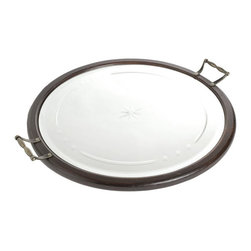 Round Mirrored Tray - This exquisite Round Mirrored Tray reflects just the right shades of antiquity and high-class craftsmanship. It is new from our French collection and designed to complement the subtle room settings. It features a round shape adorned with glass and two handles on the sides to hold the tray rightly.