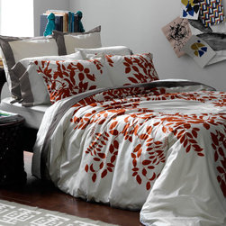 Hedgerow Persimmon Duvet Collection | DwellStudio - With a botanical-inspired pattern set on luxurious linens, the Hedgerow Persimmon Duvet Collection brings luxe flora and fauna into the bedroom. Taking inspiration from vintage prints of formal garden plans, this pattern explores landscape architecture from up close and far away. The vivid, saturated color and crisp print of this collection makes it very appealing and a sleek, modern addition to any home. Made of super soft 100% cotton sateen, this duvet collection is just as cozy as it is stylish with its vivid persimmon hues. Included in all of DwellStudio's duvet sets are a beautiful duvet cover and two matching shams.