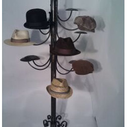 Housewares - This impressive hat rack stands 6 ft tall. Each custom stand holds your specified amount of hats. Fullering is used to create the fishtail scrolls for the feet adding an old school character to this piece... fit for the best hats you can have made.