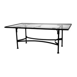 O.W. Lee Classico 84 x 44 in. Glass Top Dining Table - Designed so you don't have to worry about whether you have enough space at your table, the O.W. Lee Classico 84 x 44 in. Glass Top Dining Table is a gorgeous patio table that allows you to do all the formal and informal entertaining you wish. Handcrafted from wrought iron with Old World craftsmanship, this table is designed to easily complement your existing decor. This beautiful table features a tempered glass top and a beautiful, classic design with graceful and elegant curves. Whether you prefer large parties, intimate gatherings, multi-course meals, or a simple game night with drinks and appetizers, this glass top dining table is perfect.Unpacking and assembling the item will be left to the customer. Due to the custom-made nature of this item, orders usually ship within approximately 5 weeks. Because each item is assembled just for you, orders cannot be cancelled. A 50% restocking fee will apply for returns.This item is custom-made to order, which means production begins immediately upon receipt of each order. Because of this, cancellations must be made via telephone to 1-800-351-5699 within 24 hours of order placement. Emails are currently not acceptable forms of cancellation. Thank you in advance for your consideration in this matter.Materials and construction:Only the highest quality materials are used in the production of O.W. Lee Company's furniture. Carbon steel, galvanized steel, and 6061 alloy aluminum is meticulously chosen for superior strength as well as rust and corrosion resistance. All materials are individually measured and precision cut to ensure a smooth, and accurate fit. Steel and aluminum pieces are bent into perfect shapes, then hand-forged with a hammer and anvil, a process unchanged since blacksmiths in the middle ages.For the optimum strength of each piece, a full-circumference weld is applied wherever metal components intersect. This type of weld works to eliminate the possibility of moisture making its way into tube interiors or in a crevasse. The full-circumference weld guards against rust and corrosion. Finally, all welds are ground and sanded to make a seamless transition from one component to another.Each frame is blasted with tiny steel particles to remove dirt and oil from the manufacturing process, which is then followed by a 5-step wash and chemical treatment, resulting in the best possible surface for the final finish. A hand-applied zinc-rich epoxy primer is used to make a protective undercoat against oxidation. This prohibits rust from spreading and helps protect the final finish. Finally, a durable polyurethane top coating is hand-applied, and oven-cured to ensure a long lasting finish.About SunbrellaSunbrella has been the leader in performance fabrics for over 45 years. Impeccable quality, sophisticated styling and best-in-class warranties prove the new generation of Sunbrella offers more possibilities than ever. Sunbrella fabrics are breathable and water-repellant. If kept dry, they will not support the growth of mildew as natural fibers will. Beautiful and durable, Sunbrella is a name you can trust in your outdoor furniture.About O.W. Lee CompanyAn American family tradition, O.W. Lee Company has been dedicated to the design and production of fine, handcrafted casual furniture for over 60 years. From their manufacturing facility in Ontario, California, the O.W. Lee artisans combine centuries-old techniques with state-of-the-art equipment to produce beautiful casual furniture. What started in 1947 as a wrought-iron gate manufacturer for the luxurious estates of Southern California has evolved, three generations later, into a well-known and reputable manufacturer in the ever-growing casual furniture industry.