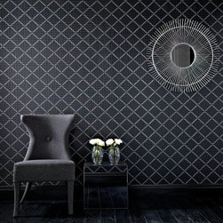 """Graham & Brown Quantum Wallpaper - Black and silver gloss pinstripes and shimmering glitter highlights layer to create this stunning diamond geometric effect wallpaper. A sublime palette confidently grounded in neutrals and monochromes. About Graham & Brown Founded in 1946 by friends Harold Graham and Henry Brown Graham & Brown has always been about brightening the home. From modest beginnings with surplus metallic paper and an embossing machine Graham & Brown has grown to include a range of products such as Superfresco - easy to hang and able to be painted or washed - and other """"""""paste the wall"""""""" products that allow homeowners greater ease in hanging wallpaper themselves. The company's product line today includes wall art paint and children's decor in addition to its famous wallpaper."""