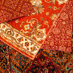 Abbey Carpet SF Showroom - Traditional red patterned rug samples.