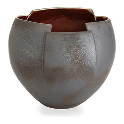 Gerald Bowl - This is a bowl for the bold, those seeking a decorative accent neither fussy nor flimsy, dainty nor delicate. Generously sized, the Gerald Bowl presents a matte gunmetal exterior finish that boasts variations in color and texture suggestive of the passage of years. The sliced and angled rim allows for the prominent display of the ox blood interior that contrasts dramatically with the neutral exterior.