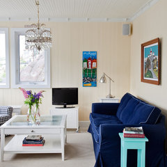 eclectic family room by CapeRace Cultural Adventures