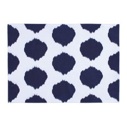 KAF Home - Ikat Navy Dot Placemat, Set of 4 - This unique design is formed by binding bundles of threads with a tight wrapping applied in the desired dot pattern. A perfect option to complement your kitchen decor.
