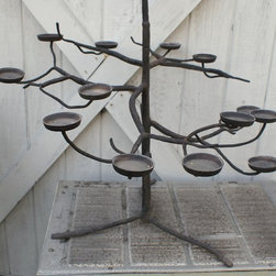 "Garden Accents and Accessories - Iron tree-shaped sculpture holds candles and looks amazing doing it.  40"" tall and 30"" wide, this tree is a substantial piece that can serve as a focal point for your patio decor.   See our website for pricing and more items for sale."