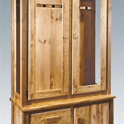Montana Woodworks - Gun Cabinet in Stained and Lacquered Finish - Handcrafted. Trim pieces are sawn square. Heirloom quality. Durable build and fit. Edge glued panels. Felt edged racks protect firearm's finish. The cabinet holds eight rifles or shotguns. Two small drawers and a storage area holds ammo and other sporting essentials. Made from solid grown wood and timbers. Made in USA. No assembly required. 42 in. W x 17 in. D x 72 in. H (122 lbs.). Warranty. Use and Care InstructionsMontana woodworks, the largest manufacturer comes the all new homestead collection line of furniture products. What better way to store your prized firearms than have them embraced by the timeless beauty of lodge pole pine, while still being able to view them through the glass?. What better way to show off your prized possessions?. Each piece signed by the artisan who makes It.