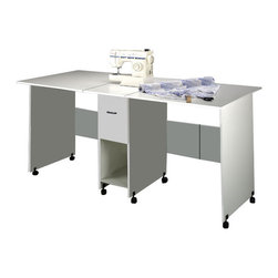 Venture Horizon - Craft Table with Drawer - White - Maximum Work Space For All Projects. Ours may be the largest, folding craft table in the world. Fully extended the surface provides 19 sq. ft of work space. That's practically double that of any standard size desk. Yet, when folded the craft table occupies only 3 sq. ft. of floor space. It's countertop height is great for working while standing up, making it ideal for sewing , quilt making, art projects, model making and more. One deep, oversized drawer plus a spacious shelf provide more than adequate storage for a sewing machine, fabric and other essential materials. Dual track carper casters provide mobility for easy storage. Constructed from durable, easy to clean, stain resistant, melamine laminated particle board. Available in either white or oak. Measures 35in. high x 76in. wide (fully extended) x 36in. deep and weighs 95 lbs. Easy assembly required. Made in the USA.