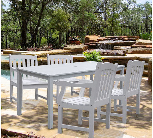 Vifah - Bradley Rectangular Extension Table & Armchair Outdoor Wood Dining Set - Bringingtogether the charm and beauty of white furniture, Bradley Rectangular Extension Table & Armchair Outdoor Wood Dining Set makes your outdoor dreams a reality. In Acacia hardwood, grown in 100% well managed forests, certified by the FSC (Forest Stewardship Council), which is not only wear- and tear-resistant, water repellent, weather- and rot-resistant, but also insect-resistant  this set will last for years to come. The table is ready for shade with an umbrella hole. The armchairs have been designed for patio, garden, or backyard with comfortable contoured seat and back. These armchairs and table offer enough place to serve 4 people dining outside. Order today and enjoy your precious time with this gorgeous addition.; Warranty: 1 year against manufacturing defects; Assembly:The table and armchair can be assembled; Item type: Outdoor Dining Set; Style: Traditional; Packaging: 1 table and 4 armchairs; Finish: White painted; Wood: FSC Acacia; Protective qualities: Mold, mildew, fungi, termites, rot and decay-resistant; Table: Slatted top, ready for shade with an umbrella hole; Armchair: Contoured back, contoured seat, with armrests; Sustainable claims: Renewable resource; Sustainable certification: Forrest Stewardship Council (FSC); Dimensions: Table:59L x 32 W x 29 H (inches), 33 lbs.; Armchair: 23L x 23 W x 35 H (inches), 26 lbs.