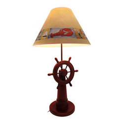 Wooden Ship's Wheel Table Lamp with Nautical Shade - This beautiful wooden ship's wheel table lamp is the perfect accent to rooms with a beach or nautical theme. It measures 30 inches tall, has an 8 inch diameter base, and comes with a coordinating 16 inch diameter shade featuring things you might find along the coast, such as sailboats, seagulls, and lobsters. The lamp uses a 75 watt (max) type A bulb (not included), and has a black 4 foot long power cord. It makes a lovely gift that is sure to be admired.