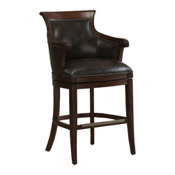 Waldorf Bar Stool - Take a seat in the lap of luxury. Solidly constructed with a bonded leather cushion, antique brass footplate and classic nailhead trim, this stylish stool will add some serious sophistication to your counter.