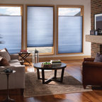 Energy Efficient Honeycomb shades with sidetracks - Symphony Shades with the ComforTrack Plus system save even more energy by adding a 4 sided seal.  Not only is the fabric blocking drafts (both heat and cold), but the side tracks bridge the gap on the sides of a traditional shade.  Great for any room in the house.  Side tracks are available in white or brown and can blend into most woodwork. Available with the top down bottom up option. Shade shown in 157 Nocturne Double Cell Light Filtering fabric. An affordable alternative to Hunter Douglas Duette Architella Photo by Comfortex