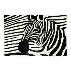 Homefires - Zebra On Zebra Rug - Distinctive black and white stripes give this rug a yin yang punch. Often the animal lives in harems, but this solo-striped beast will complement your modern decor or make a zebra freak very happy.