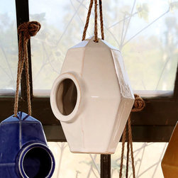 Perch Ceramic Bird House - White - Bring upscale geometry into the garden with the Perch Ceramic Bird House.  A hollow, gem-shaped form with a round door wide enough for moderately-sized songbirds, this pointed hexagonal home can be either set on its flat base or hung from the included rope hanger.  Its white glaze brings clean, updated style to the realm of the outdoors.