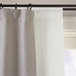 """Blackout Drape Liner, 46 x 104"""" - Designed as a layering piece under other drapes, our dense Blackout Drape Liner blocks light, absorbs noise, insulates against heat and cold, and protects drapery, rugs and furniture from fading. Blackout lining minimizes light filtration. Hangs from pole pockets or converts to ring-top style with the included drapery hooks. Use with 10 Clip or Round Rings (sold separately). Woven of 67% polyester-33% cotton. Liner is 4"""" shorter and 4"""" narrower to fit snugly behind the drapes. Watch a video on {{link path='/stylehouse/videos/videos/h2_v1_rel.html?cm_sp=Video_PIP-_-PBQUALITY-_-HANG_DRAPE' class='popup' width='420' height='300'}}how to hang a drape{{/link}}. Catalog / Internet Only. Imported."""