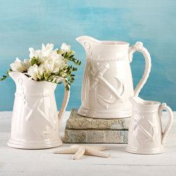 Anchor Away Crackled Finish Pitchers - Set of 2 - The rope texture used for elegant garland and drapery designs on fine porcelain ware takes on a playful, nautical tone here in the Anchor Away Crackled Finish Pitchers, where an off-kilter anchor provides a tone-on-tone motif.  This pair of pouring vessels recommend themselves for use as vases in a bay window or as a standby of the breakfast table.