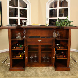 American Heritage - American Heritage Augusta Bar in Suede - Classic style and thoughtful function come together to create the perfect entertaining piece. The radiant suede finish adds to the appeal of the raised panels while the brushed steel footrest follows the contours of the bar. Additional features include locking cabinets for additional security  storage and display of wine bottles and other glass/barware.  Add this dynamic piece to your homes décor today.