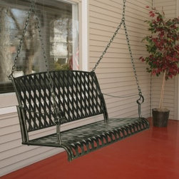 International Caravan 4 ft. Wrought Iron Diamond Lattice Porch Swing - Spruce up your front porch or backyard with the International Caravan 4 ft. Wrought Iron Diamond Lattice Porch Swing. This swing features a timeless design of wrought iron straps arranged in a diamond lattice pattern. A dark marble green finish adds an apt finishing touch to match any outdoor setting. With its durable construction and special weather-resistant finish this porch swing will provide soothing comfort and enjoyment for years to come. The International Caravan 4 ft. Wrought Iron Diamond Lattice Porch Swing goes through an extensive finishing process to ensure that you receive a product that will retain its beauty for years. The base coat of this porch swing is applied via electrophoresis. It is dipped in a tank of special electrophoretic paint solution and an electric current is run through it causing the charged paint particles to attract to the iron. The swing is removed and hung to dry. It is then baked in an oven at high temperatures. Finally it is powder coated and baked a second time. The end result is an extremely durable and weather-resistant finish that will look like new season after season.