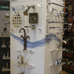 Our Showroom - Altmans Products display tower showcasing a variety of bathroom faucets.