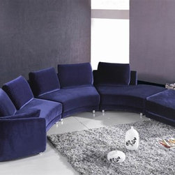 Leo Wrap-Around Sectional - This deep purple circular couch is great for entertaining or lounging. Layer on the pillows and shawls for a true Stevie Nicks vibe.