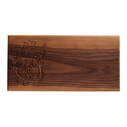 DMWR - Heart Cutting Board - You put love into every dish you prepare. Now you can really show that love with this carved heart cutting board made from solid walnut by Dave Marcoullier.