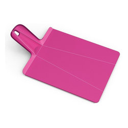 "Joseph Joseph - Joseph Joseph ""Chop2Pot"" Plus Large Cutting Board, Pink - Developed with designer Mark Sanders, this Chop 2 Pot cutting board allows you to chop your fruits and vegetables on a safe surface that conveniently folds for transport to your pot or bowls. This innovative chopping board uses the latest technology in polypropylene living hinges, when the handle is squeezed the product folds into a chute to help guide diced and chopped food into the pan, pot or bowl. The handle also has a hole for hanging. Available in green, white, pink, black, red, blue and aubergine."