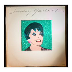 """Glittered Judy Garland Warhol Album - Glittered record album. Album is framed in a black 12x12"""" square frame with front and back cover and clips holding the record in place on the back. Album covers are original vintage covers."""