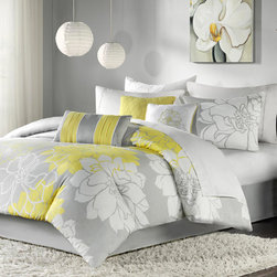 "Madison Park - Lola Comforter Set - Lola is the perfect solution to an updated, modern print look. This comforter set features an overscaled floral print design printed on 100% cotton fabric for a super soft hand feel. The reverse of the comforter is a soft grey color that coordinates with the grey, white and yellow from the face of the comforter. The decorative pillows feature embroidery and piecing details. Features: -Set included 1 comforter, 2 king shams, 1 bedskirt and 3 decorative pillows. -Color: Grey / yellow. -Material: 100% Cotton sateen jacquard. -180 Thread count cross weave backing. -Embroidered decorative pillows. -Dimensions: 90""-104"" Height x 90""-92"" Width."