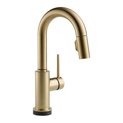 "Delta - Delta 9959T-CZ-DST Trinsic Series Deck-Mounted Pull-Down Kitchen Faucet - The Delta 9959T-CZ-DST is a Trinsic Series Deck-Mounted Pull-Down Kitchen Faucet. This deck-mounted pull-down kitchen faucet features a Two-Function pull-down spout sprayer, a solid brass fabricated body, and a single lever handle for precise temperature and volume control. This model has a 13"" tall 6-1/2"" long spout, and a Touch-Clean spray head that allows for less mineral build-up. Itcomes with a MagnaTite docking system, and dual integral check valves in the sprayer for less backflow. This faucet also comes with an optional 10-1/2"" keyed escutcheon for an easier installation, and a 1.8 GPM flow rate. This faucet is ADA and CalGreen compliant, and it features Delta's Touch20 Technology for easy on/off functioning when you don't have hands to turn the handle. This model comes in a refined, Champagne Bronze finish."