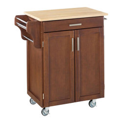 Home Styles - Home Styles Furniture Kitchen Cart in Cherry - Home Styles - Kitchen Carts - 90010071 - The freedom to conduct food /beverage preparation anywhere you wish sums up the entire appeal of the Home Styles Cherry Wood Cart. Whatever the task entails this cart is more than up to it with a hardwood table top long utensil drawer and single adjustable shelf lower cabinet. Four wheel casters allow for freedom of movement and feature a locking function for safety. Two side-mounted towel racks and a spice rack add further practicality while a cherry finish blesses this cart with an inherent warmth.