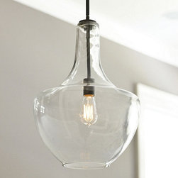 Ballard Designs - Sawyer 1-Light Pendant - Hardware is crafted of steel. Hand applied Olde Bronze finish. This pendant offers a light and airy look that's just right for small spaces or for when you prefer a less intrusive design that doesn't compete with other elements in a room. Clear glass shade with cut mouth opening reveals the classic styling of early industrial lighting. Add our Vintage Bulb (sold separately) to complete the look.Sawyer 1-Light Pendant features: . .