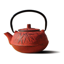 Old Dutch International - Red Cast Iron 'Osaka' Teapot - Make teatime truly special with this stunning Japanese-style cast iron teapot. This gorgeously shaped pot features a black porcelain enamel interior coating to ward off rust and a stainless steel tea brewing basket for your favorite loose teas. This 20 ounce classically designed teapot comes in your choice of chic colors: blue or red.