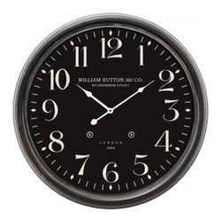 YOSEMITE HOME DECOR - 25 in. Circular Iron Wall Clock black distressed iron frame - Bring the charm of European style to your home with this sleek all black wall clock. The frame is constructed of iron with a traditional circular frame and white numbers, and hands giving it a dramatic contrast against the black. The words WILLIAM SUTTON AND CO. 85 CHEAPSIDE STREET in block lettering are stamped just under the twelve with LONDON 1894 just above the 6.